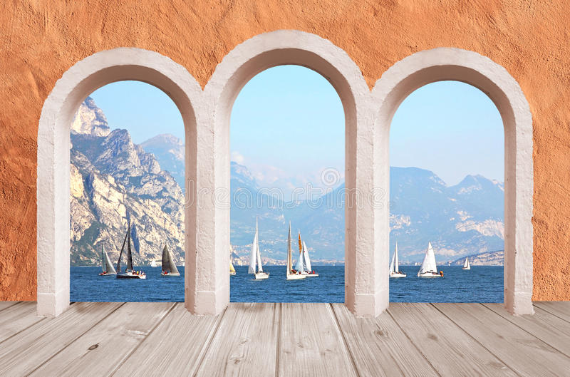 Beautiful arcade, vintage wall with lake view to sail boats and stock photography