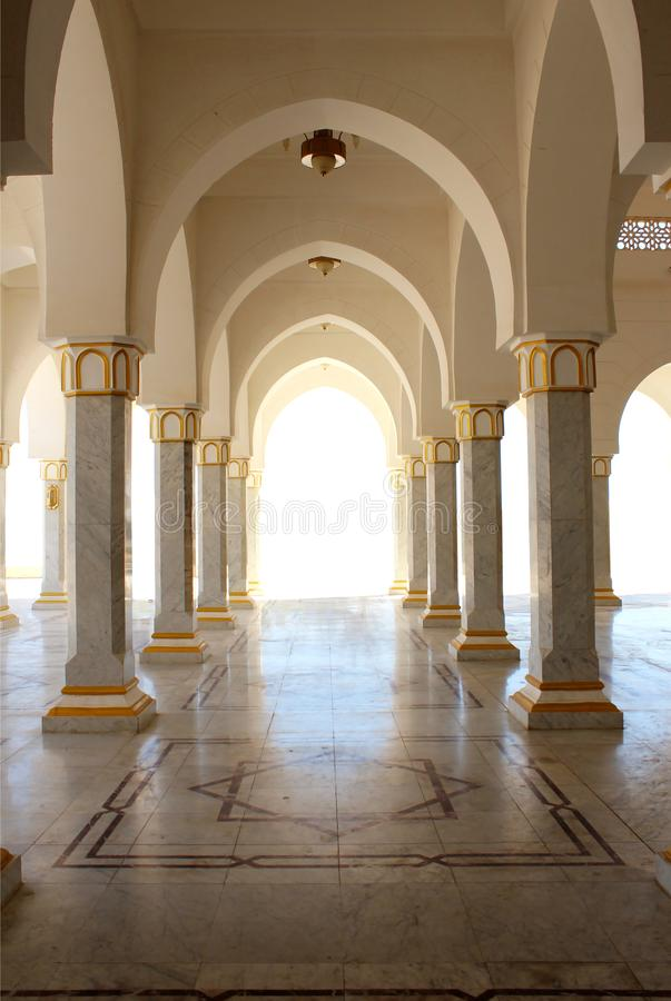 Beautiful arch, columns and marble floor. stock images