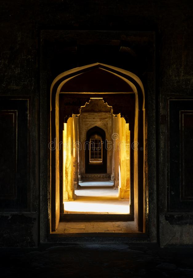 The beautiful arched doors inside Datia Palace. The image shows the arched doors of a palace in Datia, Madhya Pradesh, India and the natural light stock photo