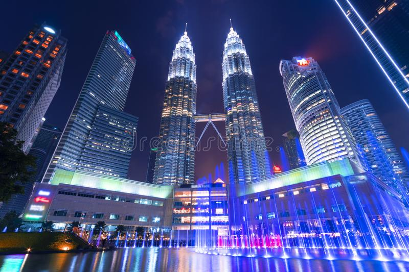 Beautiful architecture building exterior in Kuala Lumpur city in Malaysia for travel at night with urban famous stock images