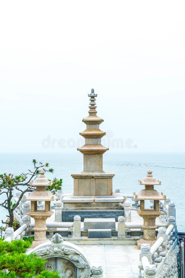 Beautiful Architecture at Haedong Yonggungsa Temple sits upon a. Cliff in Busan, South Korea royalty free stock photo
