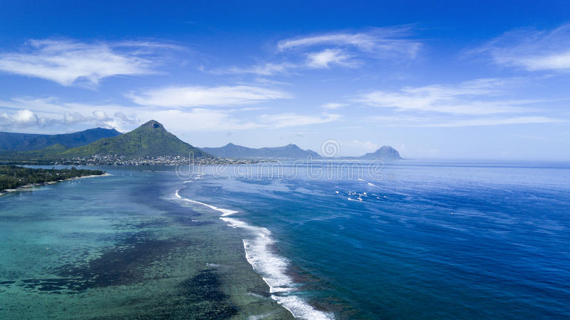 Beautiful aerial view of ocean and reef, Island of Mauritius. Beautiful aerial view of ocean and reef in Flic en Flac with mountains on horizon, Island of stock photography