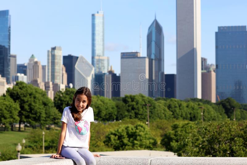 Beautiful argentinian little girl in the City of Chicago during summer vacations royalty free stock images