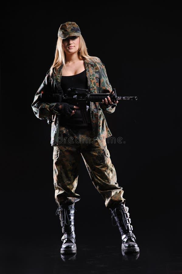 Beautiful army girl with gun stock photography