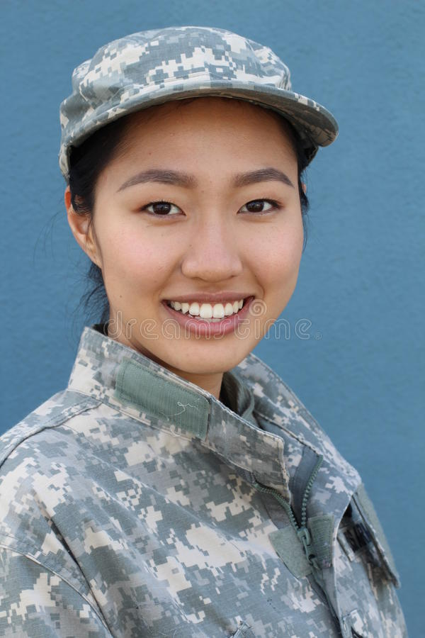 Beautiful army girl isolated on a blue stock photography