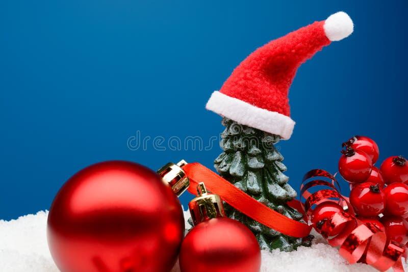 Shiny Christmas decor in snow stock photography