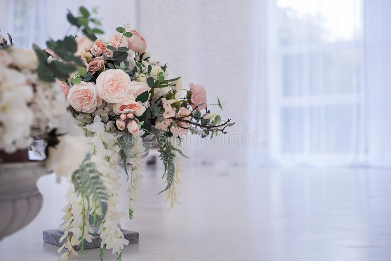 Beautiful artificial flowers in a glass vase. Elegant detail of an interior royalty free stock image