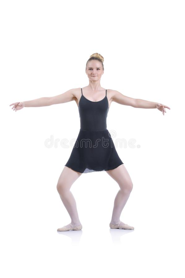 Beautiful artistic female ballerina working out, performing ballet element stock photo