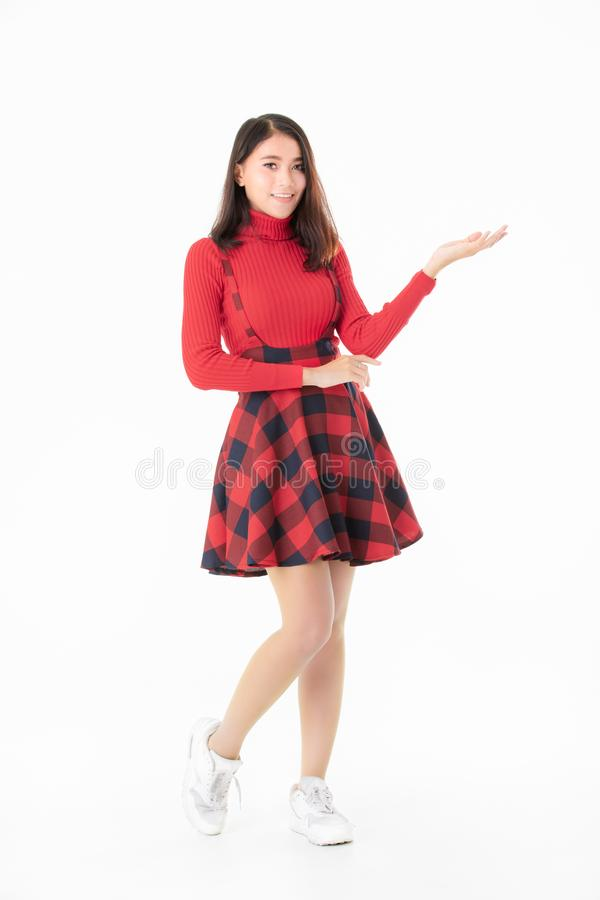 Beautiful Asain portrait woman in red casual dress standing and royalty free stock images