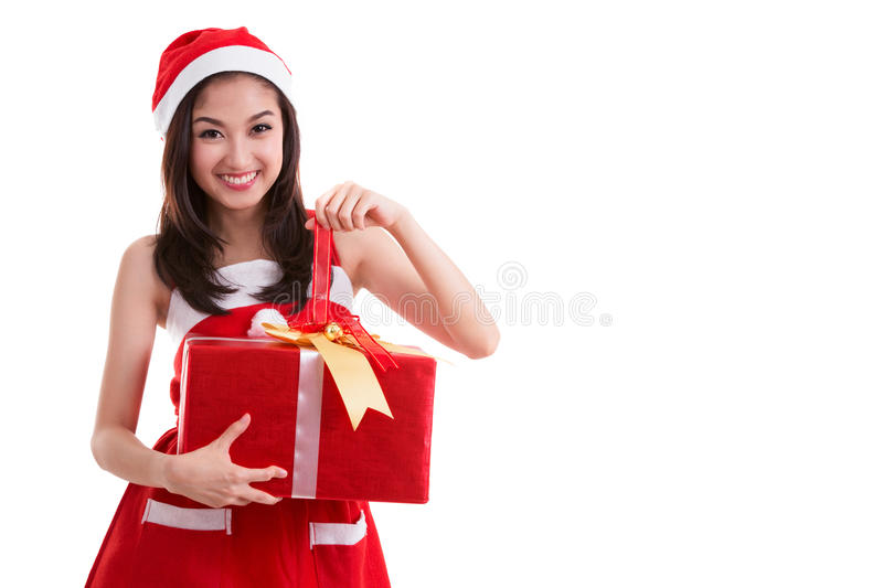 Beautiful Asia woman wear Santa Clause costume. Christmas girl happy smile hold new year gift box present, in isolated on white background royalty free stock photo