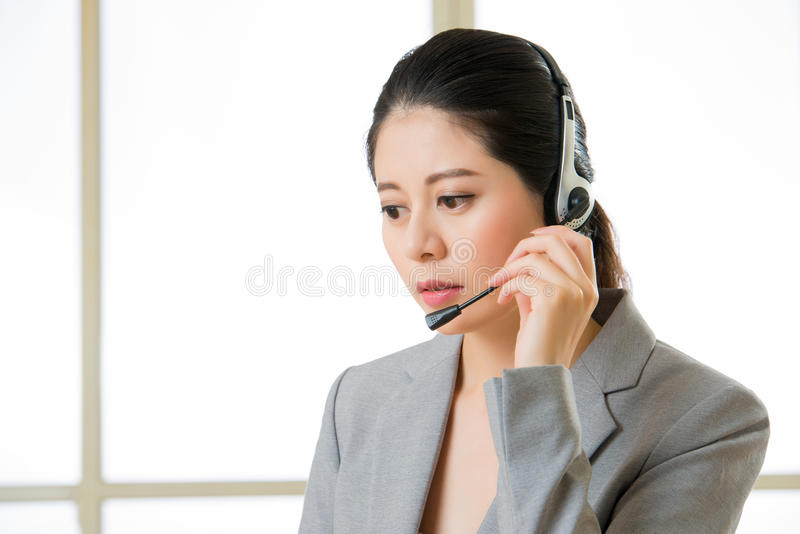 Beautiful asian business customer service woman with a headphone royalty free stock photos