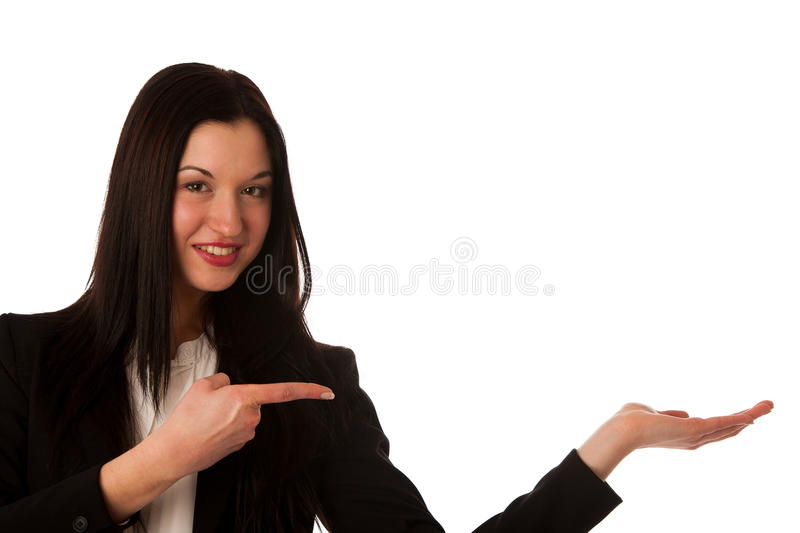 Beautiful asian business woman pointing into copy space - sales royalty free stock photo