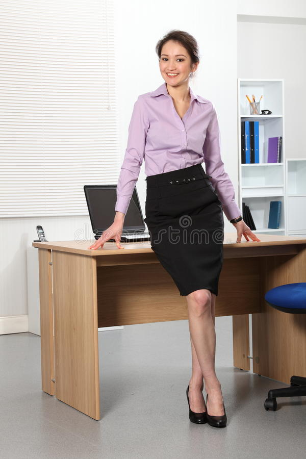 Beautiful Asian business woman standing in office royalty free stock images