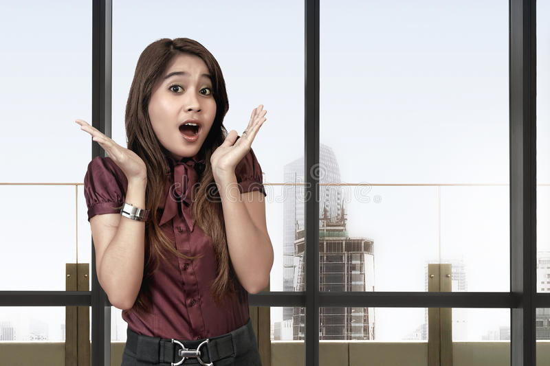 Beautiful asian business woman with surprised face expression royalty free stock photos