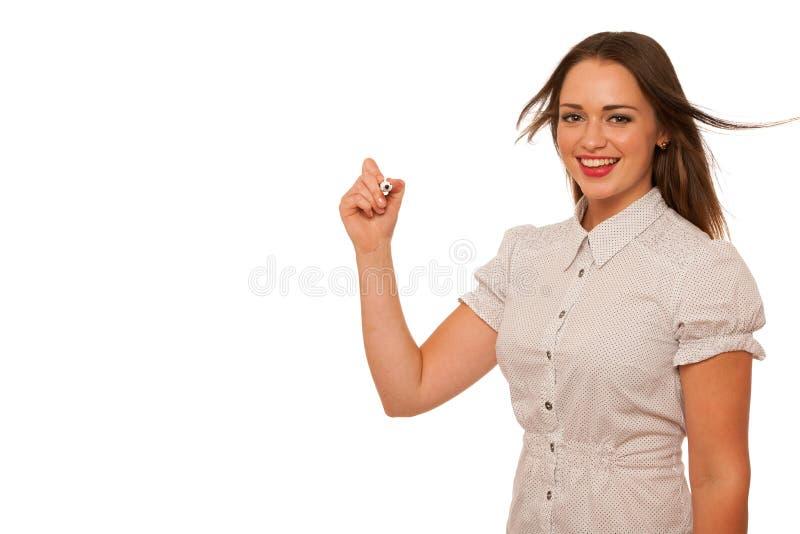 Beautiful asian caucasian woman writing presentation with marker royalty free stock photo