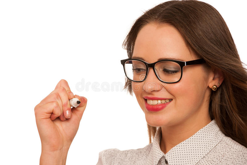 Beautiful asian caucasian woman writing presentation with marker. Isolated stock photography