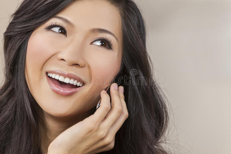 Beautiful Asian Chinese Woman Talking on Cell Phone royalty free stock photo