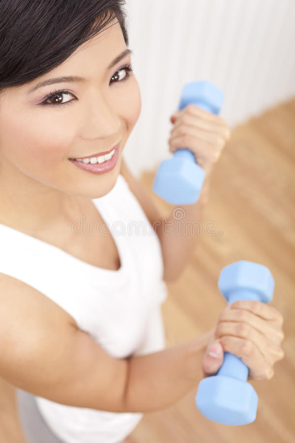 Beautiful Asian Chinese Woman With Weights At Gym royalty free stock images