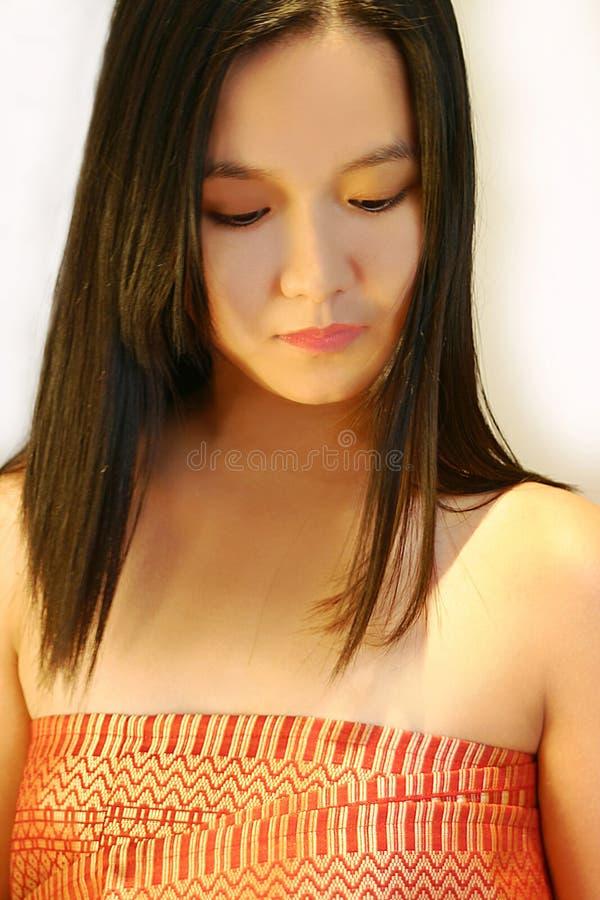 Beautiful asian girl. Young asian beauty with long black hair, wearing a Malong or Sarong stock photography