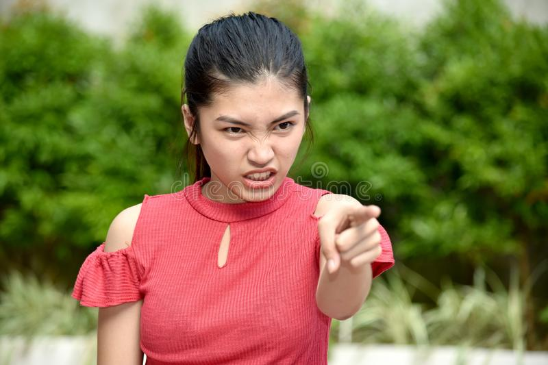 A Beautiful Asian Girl And Anger royalty free stock images
