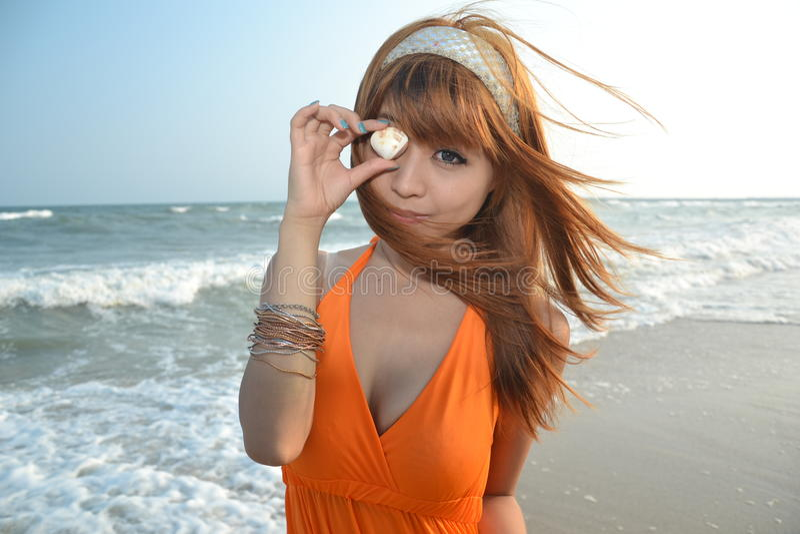 Beautiful Asian girl at the beach stock photography