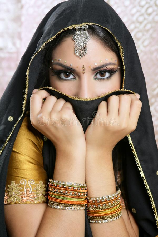 Beautiful asian girl with black veil on face. Beautiful brunette asian girl with black veil on face, traditional indian costume stock image