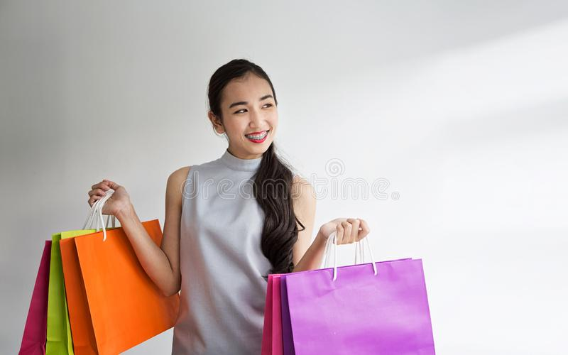 Beautiful asian girl carrying shopping bags. Shopping woman smiling. Beautiful Asian girl. young shopper stock photos