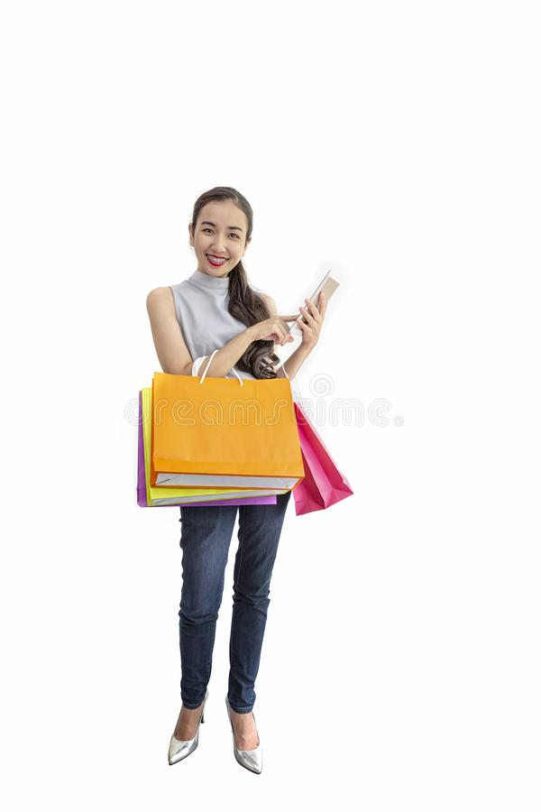 Beautiful asian girl carrying shopping bags. Shopping woman smiling. Beautiful Asian girl. young shopper royalty free stock images