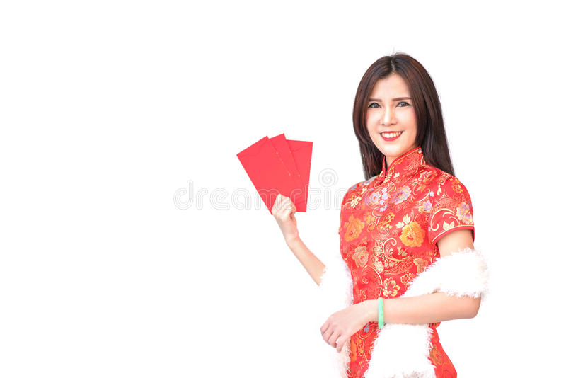 Beautiful Asian girl in Chinese qipao traditional dress, holding red money pockets or greeting card envelopes. Chinese new year concept, isolated on white royalty free stock photo