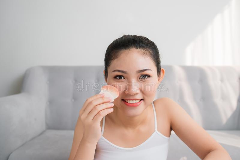 Beautiful Asian girl with cosmetic powder brush for make up. Make-up concept stock images