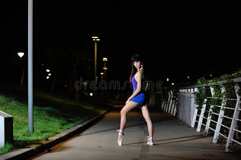 Beautiful Asian girl dancing ballet in the night stock photos