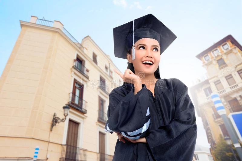 Beautiful asian girl with graduation gown and cap. At outdoor stock images