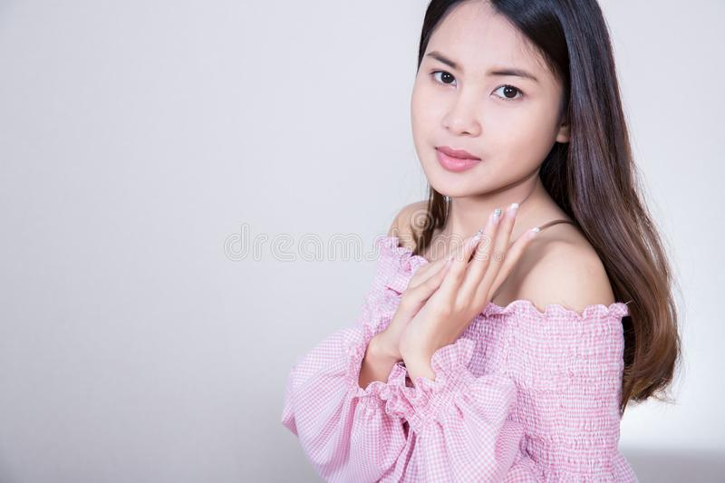 Beautiful Asian girl with healthy skin . Skincare concept. Beautiful Smiling Young Asian Woman with Clean, Fresh, Glow, and perfec stock photo