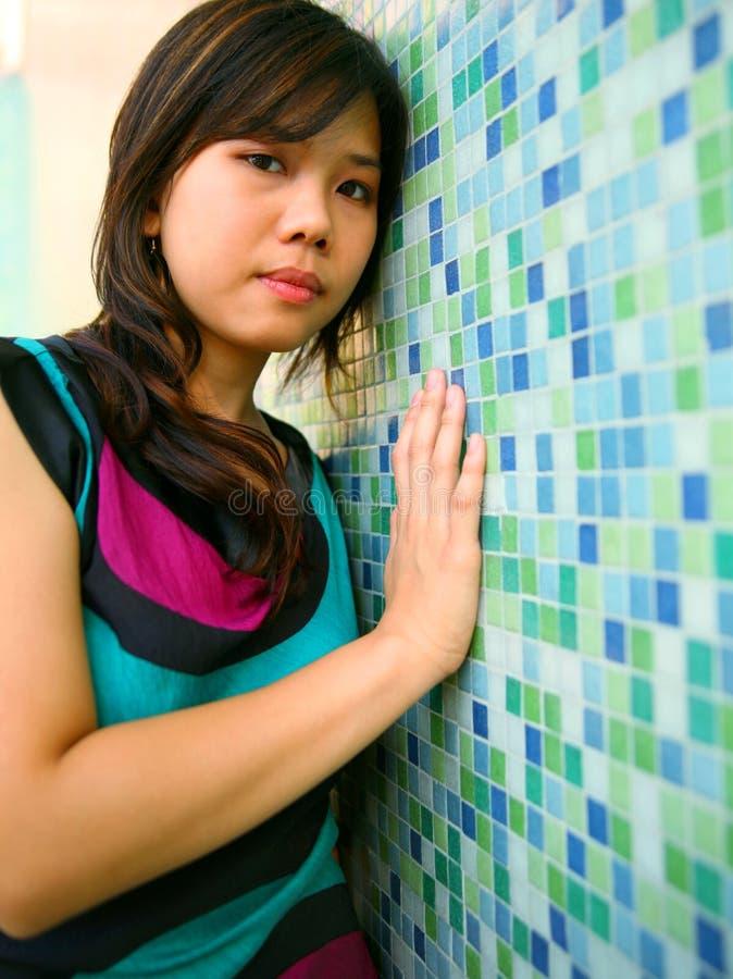 Beautiful Asian Girl Lean Blue Wall Royalty Free Stock Photos