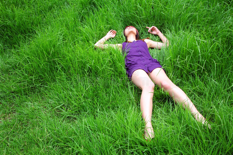 Beautiful Asian girl lying down royalty free stock images