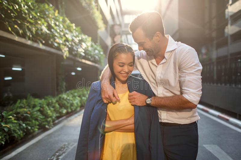 Beautiful asian girl and man together on the street royalty free stock photography