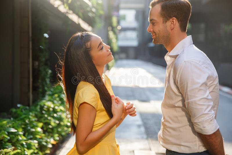Beautiful asian girl and man together on the street royalty free stock photo