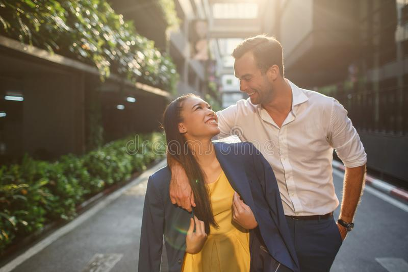 Beautiful asian girl and man together on the street royalty free stock image