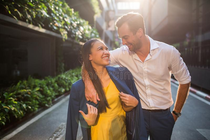 Beautiful asian girl and man together on the street stock photo
