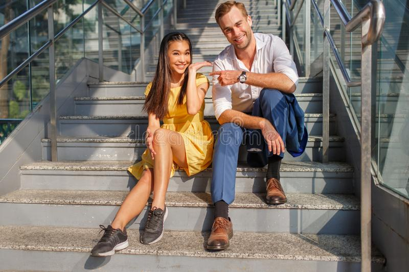 Beautiful asian girl and man together on the street royalty free stock images