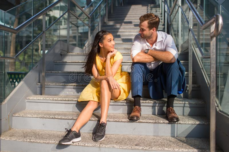 Beautiful asian girl and man together on the street stock image
