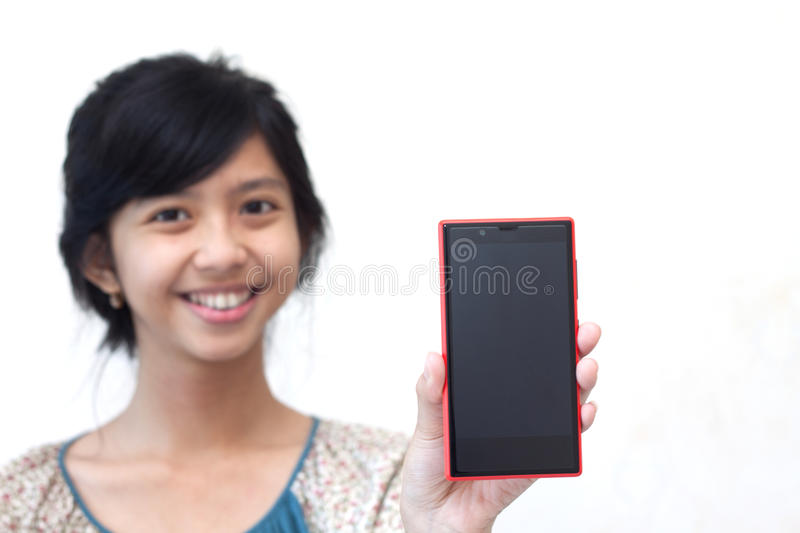 Beautiful asian girl showing her smartphone. Represent a modern live which we're all have a smartphone royalty free stock images