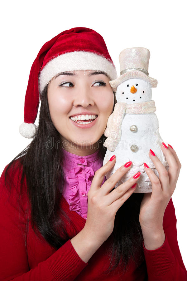 Beautiful Asian girl with snowman