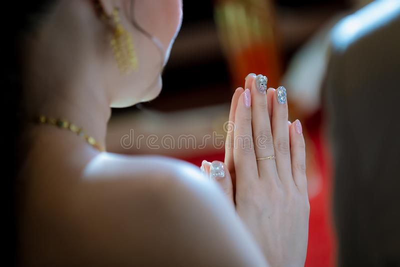 Beautiful Asian girl to pay respect and praying Buddhism worshiping Buddha statue with faith. Hands begging,. Put your hands together in a prayer position stock image