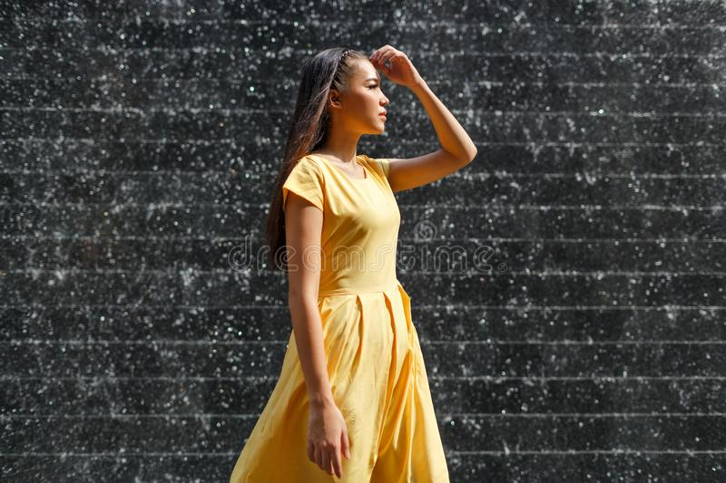 Beautiful Asian girl in a yellow dress stock images