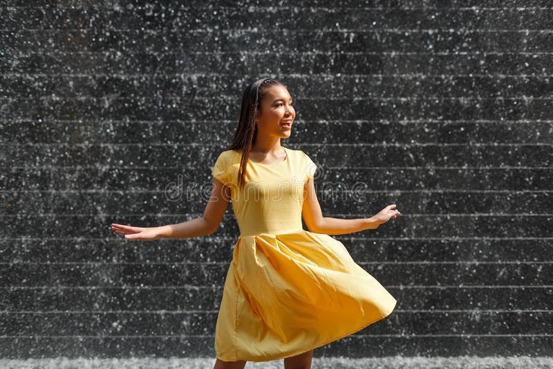 Beautiful Asian girl in a yellow dress stock image