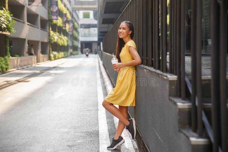 Beautiful Asian girl in a yellow dress royalty free stock photography
