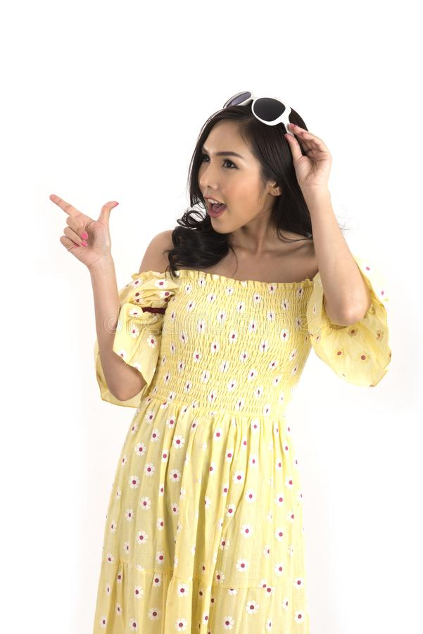 Beautiful Asian girl with yellow floral dress for spring or summer. royalty free stock photos