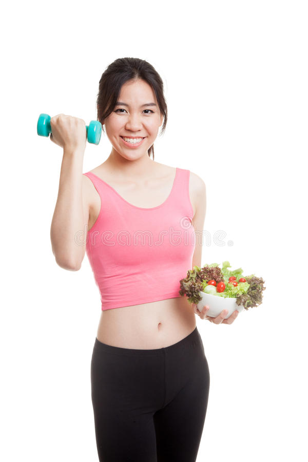Beautiful Asian healthy girl with dumbbell and salad. Beautiful Asian healthy girl with dumbbell and salad isolated on white background royalty free stock photo