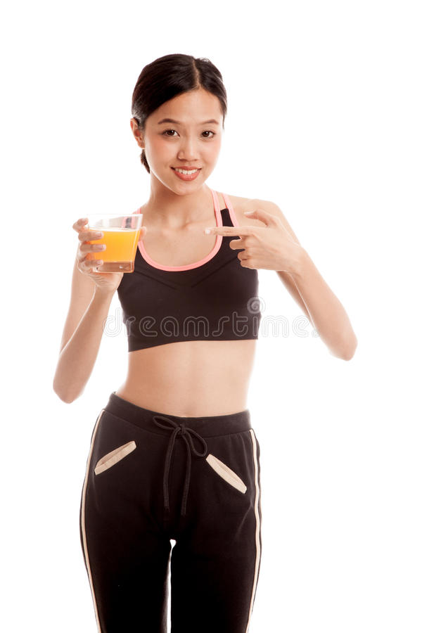 Beautiful Asian healthy girl point to orange juice royalty free stock image